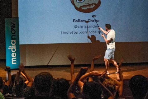 Camp instructor Chris Snider gets campers to pose for a selfie during his morning keynote at Media Now STL in 2015.