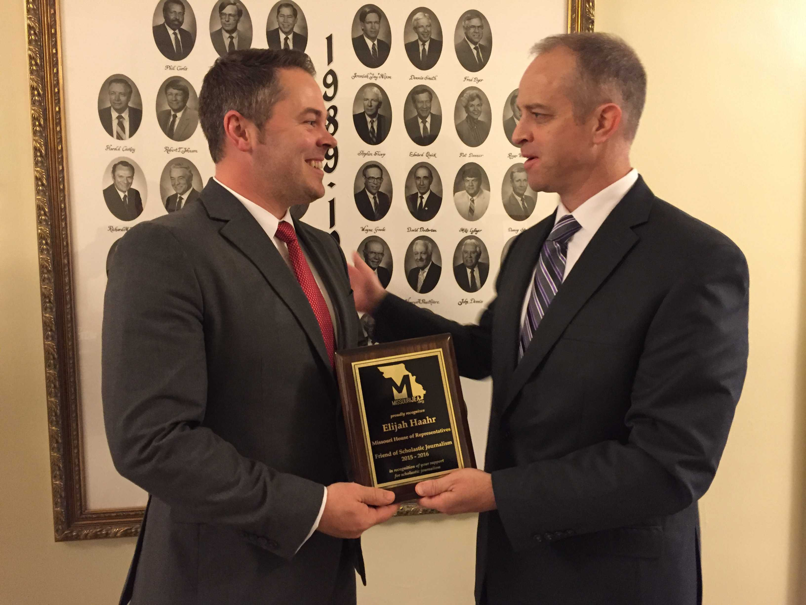 Missouri Representative Elijah Haahr receives the Friend of Scholastic Journalism Award from MJEA President Mitch Eden April 13 in Jefferson City.