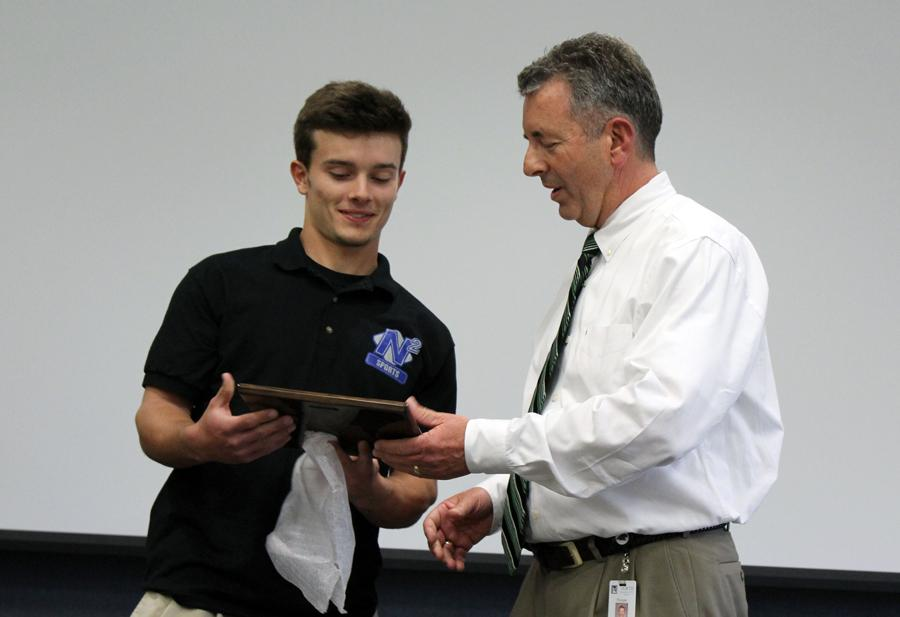 We had students from STTV (daily broadcast), Legacy yearbook, Talon newsmagazine, StaleyNews.com and N2 Sports (live sports broadcasting) present Mr. Mershon with the award. They each spoke about specific ways he has supported their particular program. It was a staff meeting, and the Superintendent was present along with Mr. Mershon's wife. The N2 sports broadcasting student (who is also in STTV) is Mr. Mershon's son, Ward Mershon, a very talented broadcast journalism student.