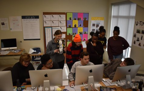 Working with U-Times newspaper editors, Mary Williams, U. City media adviser, pushes students to meet their deadline. Mid-December is an especially busy time for journalism students and every class period counts.