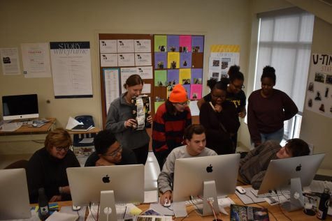 "Working with U-Times newspaper editors, Mary Williams, U. City media adviser, pushes students to meet their deadline. Mid-December is an especially busy time for journalism students and every class period counts. ""We had newspaper students fanned out across the building getting captions and late-breaking story interviews up until deadline."""